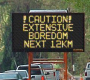 road_construction_sign_caution_extensive_boredom_next_12km.png